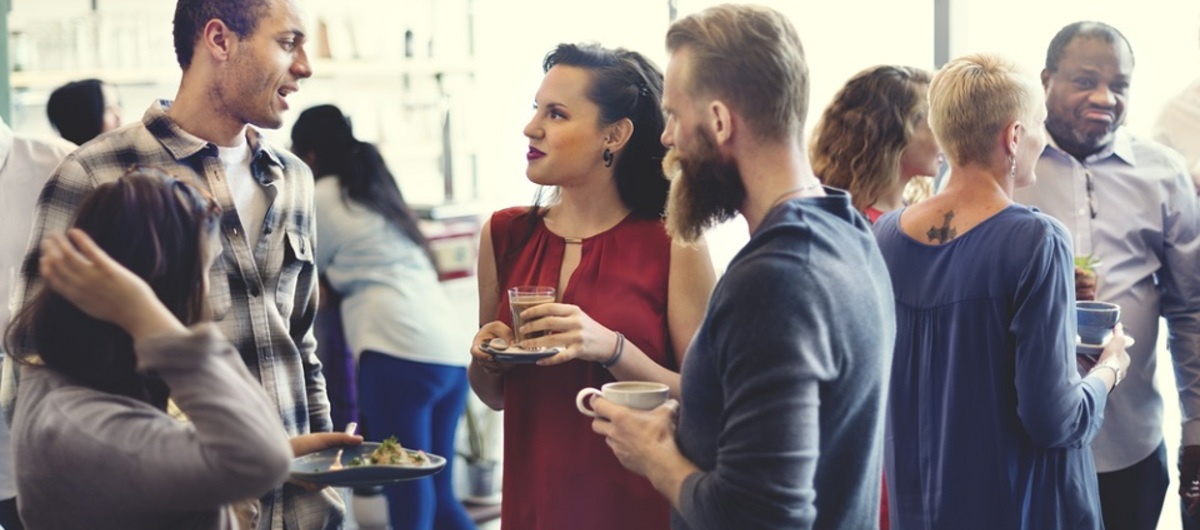 Confident workers networking at event